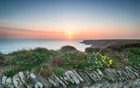 south west coast path: Sunset from the South West Coast Path at Park Head near Porthcothan on the north Cornwall coast Stock Photo
