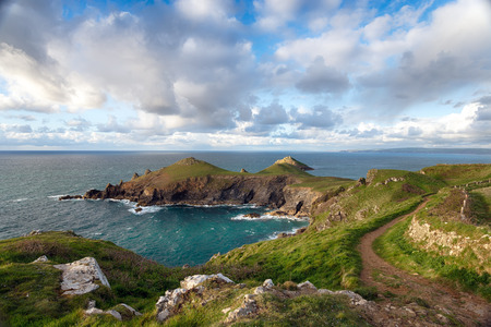 south west coast path: The South West Coast Path on the north Cornwall coast at The Rumps, a rugged promontory jutting out in to the Atlantic ocean and the site of an Iron Age hill fort