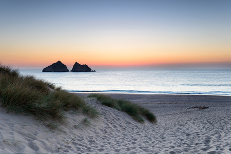 Night falls over Holywell Bay a large sandy beach backed by sand dunes on the north coast of Cornwall photo