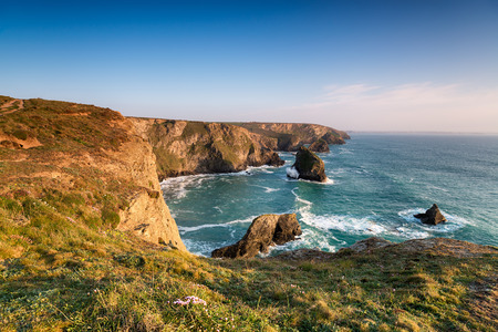 south west coast path: The South West Coast Path as it crosses Pentire Steps on the North Cornish coast looking out to the sea stacks at Bedruthan Steps Stock Photo
