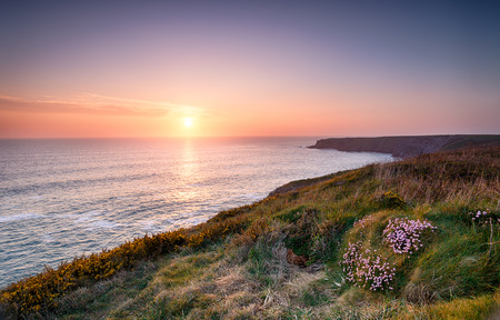 south west coast path: Sunset over the Cornwall coast on the South West Coast Path at Park Head near Porthcothan