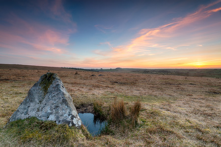 bodmin: Sunset over standing stones on Bodmin Moor in Cornwall Stock Photo