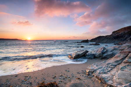 sheltered: Sunset from Little Fistral beach, a small sheltered cove beneath the Towan headland at Newquay on the Cornish coast Stock Photo