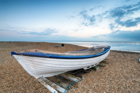 dungeness: White boat on the beach at Dungeness on the Kent coast