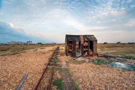 shingle: A derelict abandoned hut on a shingle beach