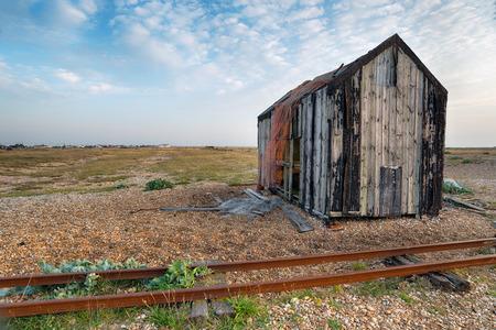 shingle beach: An abandoned fishing shack on a shingle beach in Kent
