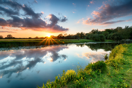 Sunset over the River Stour as it flows past Wimborne in Dorset photo
