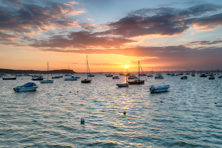 dorset: Sunset over Poole Harbour in Dorset, looking out to Brownsea Island from Sandbanks