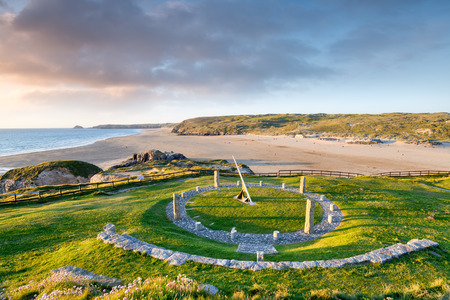 A giant sundial above the beach at Perranporth in Cornwall Imagens