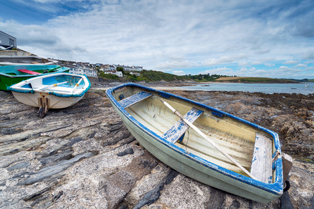 slipway: Small rowing boats lined up on the slipway at Portscatho on the Roseland Peninsula in Cornwall