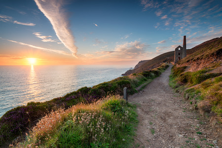 south west coast path: Sunset from the South West Coast Path as it passes the Towanroath engine house and leads toward St Agnes Head on the Cornish coast