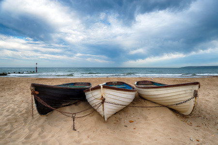 chine: Fishing boats on the beach at Durley Chine, part of Bournemouth beach in Dorset Stock Photo