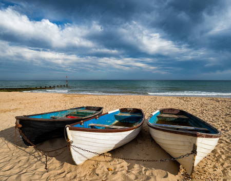 chine: Boats on Bournemouth beach at Durley Chine