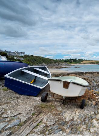 slipway: Small dinghys on the slipway at Portscatho harbour on the Cornish coast