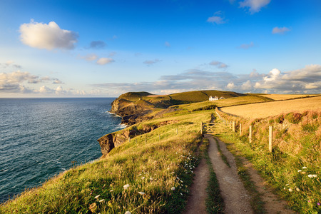 south west coast path: Approaching Doyden Point above Port Quin on the South West Coast Path in north Cornwall Stock Photo