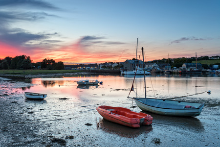 river boat: Boats at dusk on the River Tamar at Millbrook in Cornwall Stock Photo