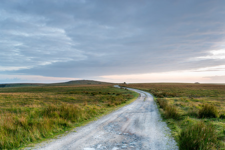 dirt background: A winding lonely track through moorland on Bodmin Moor in Cornwall