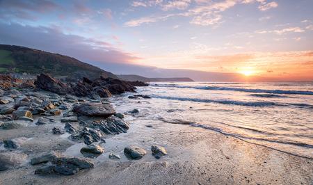 south coast: Dramatic sunrise at Portholland on the south coast of Cornwall