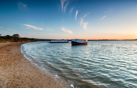 bramble: House boats on the beach at Bramble Bush Bay on Studland in Dorset