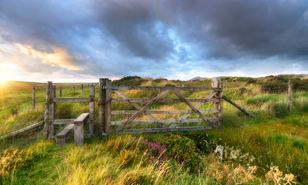 Moorland gate under a dramatic stormy sky Stock Photo