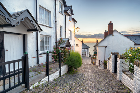 A narrow cobbled street lined with pretty cottages at Clovelly in north Devon