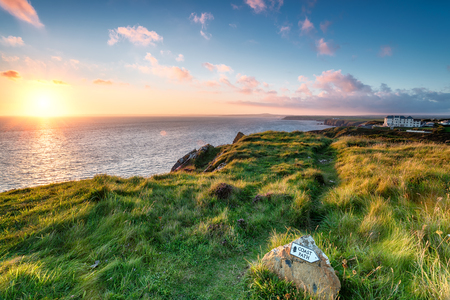 south west coast path: The South West Coast Path on cliffs above Mullion Cove on the Lizard Penisula in Cornwall Stock Photo