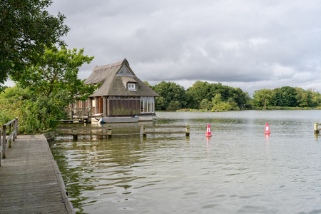 boat house: A thatched boat house on the Norfolk Broads at Malthouse Stock Photo