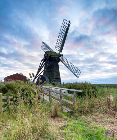 smock: A cloudy sunset at Herringfleet windmill on the Suffolk end of the Norfolk Broads