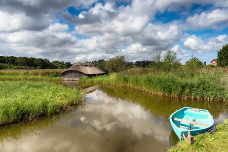 boat house: Beautiful thatched boat house and rowing boat on Hickling Broad in Norfolk
