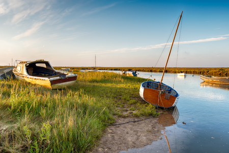 salt marsh: Fishing boats on the salt marshes at Blakeney on the Norfolk coast