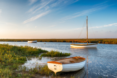 salt marsh: Boats at high tide on salt marshes at Blakeney on the north Norfolk coast