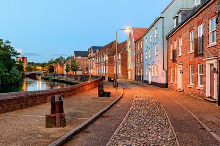 cobbled: Town houses overlooking the river Yare in Norwich, Norfolk Stock Photo