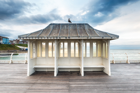 pier: A shelter on Cromer Pier on the north coast of Norfolk Stock Photo