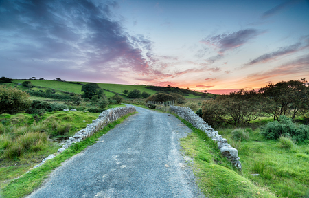 bodmin: Sunset on a winding country lane leading through Bodmin Moor in Cornwall