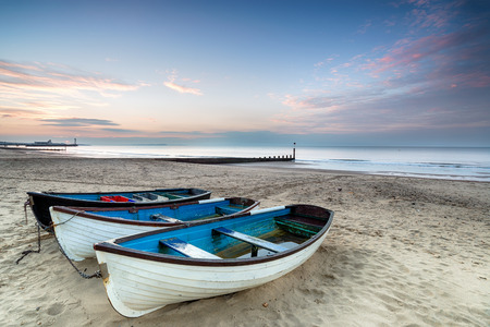 bournemouth: Sunrise over fishing boats on Bournemouth Beach