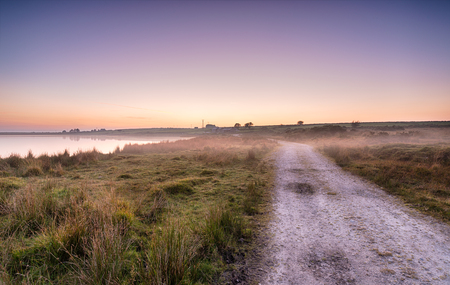 bodmin: Evening mist rolling in across moorland at Dozmary Pool a remote spot on Bodmin Moor in Cornwall