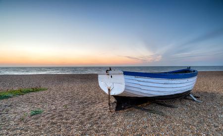 shingle beach: A fishing boat on the shingle beach at Aldeburgh on the Suffolk coast Stock Photo
