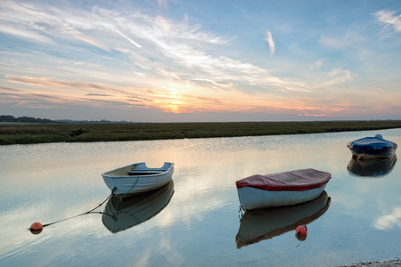 boat fishing: Rowing boats moored on the river at Blakeney on the Norfolk coast