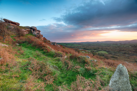 foot path: Stunning Autumn sunset from Helman Tor a steep rocky hill near Bodmin in Cornwall and a landmark on the Saints Way long distance foot path Stock Photo