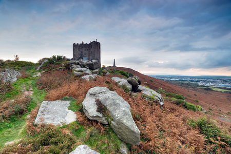 Clouds gather over Carn Brea castle above Redruth in Cornwall