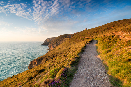 south west coast path: Evening light on the South West Coast Path at Wheal Coates near St Agnes in Cornwall Stock Photo