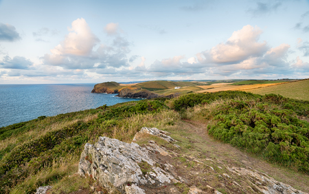 The South West Coast Path at Trevan Point and looking towards Doyden Point near Padstow in Cornwall