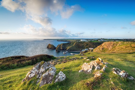 south west coast path: The South West Coast Path on cliffs above Mullion Cove on the Lizard in Cornwall Stock Photo