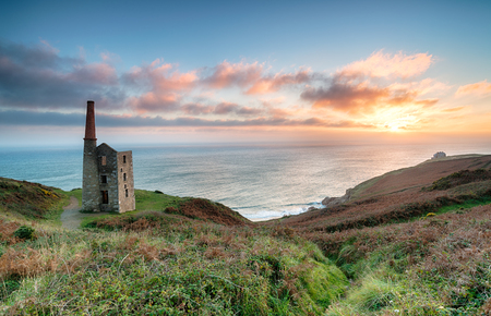 prosper: A beautiful sunset over Rinsey Head on the Cornwall Coast with the Wheal Prosper Mine engine house perched on the cliffs Stock Photo