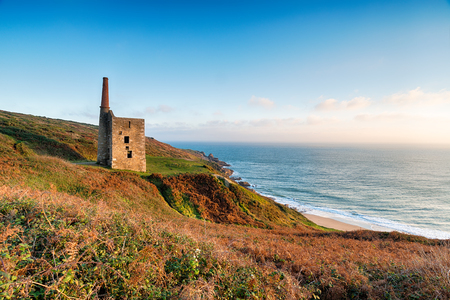 prosper: The Wheal Prosper engine house perched on cliffs at Rinsey Head near Porthleven in Cornwall Stock Photo