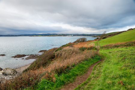 south west coast path: A winters day on the South West Coast Path as it approaches Polkerris with Par Docks and St Austell in the far distance