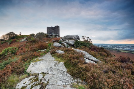 brea: Storm clouds over Carn Brea castle in the rugged Cornish countryside