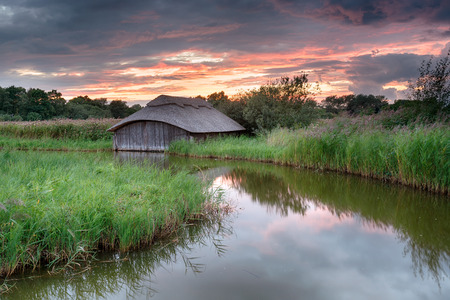 boat house: Sunset on the Norfolk Broads at a thatched boat house on Hickling Broad
