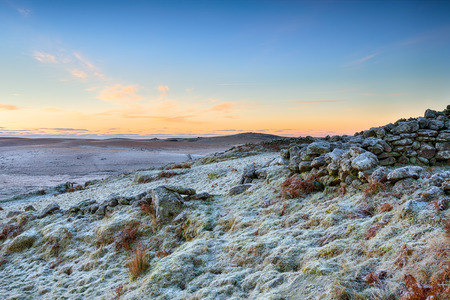bodmin: A frosty winter sunrise over rugged moorland at Garrow Tor on Bodmin Moor in Cornwall