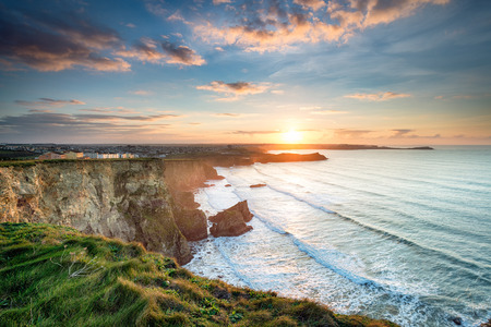 united kingdom: Stunning dramatic sunset from cliffs over Whipsiderry Beach at Porth in Newquay, Cornwall
